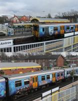 Definitely one of the better advertising vinyls. Merseyrail 508111 sports full length images promoting <I>The Beatles Story</I> attraction in Liverpool. Each of the three coaches is different leading to a very eye catching train. Seen here at Aintree on 7th February 2017 with the famous racecourse just behind the station. <br><br>[Mark Bartlett&nbsp;07/02/2017]