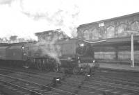 Scene at Carlisle platform 4 on the morning of Saturday 22 December 1962. Stanier Coronation Pacific no 46245 <I>City of London</I> has just taken over the 9.56 am ex-Glasgow Central for the next leg of its journey to Euston. <br><br>[K A Gray&nbsp;22/12/1962]