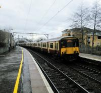 A six-car 318 in mixed livery calls at Jordan hill with a Motherwell service on 11/02/2017.<br><br>[David Panton&nbsp;11/02/2017]
