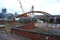 The new bridge over the River Irwell for the Ordsall Chord, seen from a train travelling between Ordsall Jct and Deal St Jct early in the morning of 25 February 2017.<br><br>[John McIntyre&nbsp;25/02/2017]