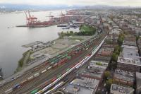 An aerial view of the freight yard adjacent to Vancouver's Waterfont Station and container terminal shows a train of containers being marshalled.  When the operation is complete the sidings will be empty and the locomotives at the head of the train will be some two miles distant ready to start their eastward journey.  Also visible in the sidings are four rakes of coaching stock for the evening's West Coast Express trains to Mission<br><br>[Malcolm Chattwood&nbsp;04/10/2016]