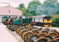 I think they've got enough axles there. From the left, side tank steamer no. 1704, a Sentinel diesel shunter, 5927 Hogwarts Express [see image 47572], and 20.905 at a Works Open Day in 2005.<br><br>[Ken Strachan&nbsp;17/09/2005]