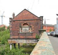 The old booking office at Partick Central standing above the overgrown platform remains in August 2006. View is east along the bridge carrying Benalder Street over the River Kelvin, running directly below the camera. At this stage planning was well advanced on redevelopment of the area and the whole site would be cleared within 6 months [see image 13369].<br><br>[John Furnevel&nbsp;27/08/2006]