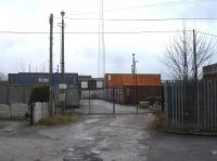 Looking towards the entrance into the former Shirebrook diesel maintenance depot in February 2017, with some of the numerous stored shipping containers that occupy the area around the building lining the access road. Other than the containers nothing else seems to have changed on site since closure.<br><br>[David Pesterfield&nbsp;08/02/2017]