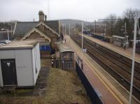 A view south over the now re-opened Shirebrook station, from a near identical position to one taken nearly 37 years earlier in 1980 [see image 4783]. As can be seen the former down side stone built building has given way to a minimalist shelter, but the main up side station building is still intact, although now in use as a business centre.<br><br>[David Pesterfield&nbsp;08/02/2017]