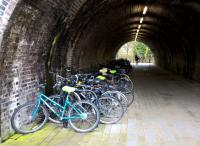 Transport interchanges are nothing new, you know. A selection of bicycles sheltering from the elements below the platforms see image [[43555]]. View looks South, towards the River Avon.<br><br>[Ken Strachan 08/11/2015]