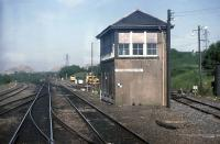 The former upper junction signal box at Greenhill, as viewed through the front windows of a Glasgow Queen Street to Dunblane DMU in June 1988. Note the sun shades on the west facing upper windows to assist the signalman's vision. The box was demolished in 1990 after the panel had been relocated nearby. <br><br>[Mark Dufton&nbsp;/06/1988]