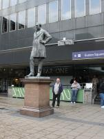 Bronze statue of Robert Stephenson, on the forecourt of Euston Station. The building of the London and Birmingham Railway was only one of many achievements in his comparatively short life. The Grade II listed statue was erected in 1871, Stephenson having died in 1859 just before his 56th birthday. <br><br>[Mark Bartlett&nbsp;26/02/2017]