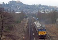 The stock of the Caledonian Sleeper led by Class 73/9 and Class 66 locos heads south out of Stirling past the site of the former Polmaise colliery sidings on 18th February 2017. The train was en route from Aberdeen to Polmadie Carriage Maintenance Depot.<br><br>[Mark Dufton&nbsp;18/02/2017]