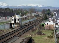 Looking from Muir of Ord station to the closed North Signal Box. Only the extra disused platform face betrays that the there was once a yard here and the Fortrose branch curved off to the right.<br><br>[Bill Roberton&nbsp;//1988]