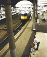 The arrival at Newcastle of a GNER service from the south fails to interrupt ballet practice in progress alongside platform 2. View west from the station footbridge in April 1997. <br><br>[John Furnevel&nbsp;05/04/1997]