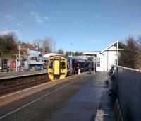 A Fife to Edinburgh service calls at Inverkeithing on 28/02/2017. The lamp columns on this half of the platform have been removed and replaced with strip lights on the fence. The back of the platform overhangs the Keithing Burn here and presumably the columns were considered to be adding unnecessary weight.<br><br>[David Panton&nbsp;28/02/2017]