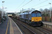 DRS 66430 slows the Carlisle to Crewe infrastructure train through Euxton Balshaw Lane on 9th March 2017, waiting for the Balshaw Lane Junction signal to clear to join the two track section to Wigan. The train mainly comprised loaded stone wagons but track machine DR77904 was also being hauled. <br><br>[Mark Bartlett&nbsp;09/03/2017]