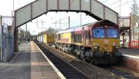 DB Cargo no.66103 passes Holytown working 4E99 from Mossend Euroterminal to Tees Dock BSC Export Berth<br><br>[Ken Browne&nbsp;09/03/2017]