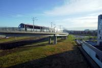 An airport - bound tram climbs from Edinburgh Park in the strong early morning sun on 27-2-17.<br><br>[Colin Miller&nbsp;27/02/2017]