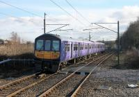 Northern 319382 has just left Euxton Balshaw Lane heading south but is held by the signal protecting Balshaw Lane Junction where the four track section of the WCML becomes two tracks. These Preston to Liverpool services had just resumed after the Lime Street cutting collapse.<br><br>[Mark Bartlett&nbsp;09/03/2017]