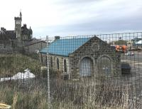 The old locomotive shed at Fraserburgh in March 2017, looking north east towards the harbour from the car park of Fraserburgh leisure centre. The building is part of a wholesale fish merchants located off South Harbour Road. [See image 38317]<br><br>[Andy Furnevel&nbsp;15/03/2017]