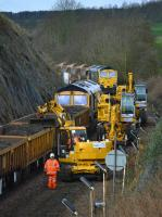 Busy scene to the west of Aberdour as a road-rail machine trims the load of spent ballast.  Freightliner 66544 is in the background.<br><br>[Bill Roberton 19/03/2017]