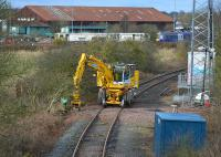 The Inverkeithing North/East chord with a road-rail machine and DR73803 waiting for the call to work at the Aberdour track renewal. A 170 passes on a diverted service.<br><br>[Bill Roberton&nbsp;19/03/2017]