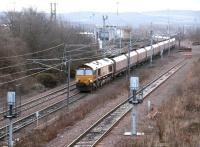 View south at Millerhill on 2 December 2003 as EWS 66246 runs through with coal empties off the ECML heading for Hunterston via the sub.<br><br>[John Furnevel&nbsp;02/12/2003]