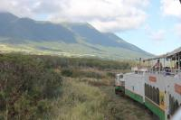 The St Kitts Scenic Railway train running north alongside the range of volcanic mountains that overlook the Atlantic Coast. <br><br>[Mark Bartlett&nbsp;18/02/2017]
