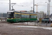 At the terminus of the newly extended line to Lansisatama / Vastrahamnen (West Harbour) is a new Transtech Oy tram built in Otanmaki, Finland. <br> The area is still 'a work in progress'.<br><br>[Colin Miller&nbsp;02/03/2017]