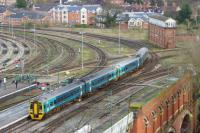 A pair of Arriva Trains Wales Class 158s departs Shrewsbury on the afternoon of 22 March 2017 heading towards Telford. The view is from the castle ramparts looking at Severn Bridge Jct and the large mechanical signalbox of the same name.<br><br>[John McIntyre&nbsp;22/03/2017]