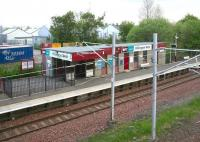 The station building on the Glasgow bound platform at Hillington West, looking from the footbridge towards the industrial area to the north of the station on a quiet Sunday morning in the spring of 2007. Four tracks ran through the station, although at this time there were only two. [In 2011 this was increased to three.]<br><br>[John Furnevel&nbsp;20/05/2007]