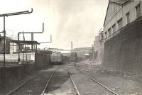 The former route to Windmillcroft Quay was cut back to West Street a few years<br> after the opening of General Terminus. This view looks north not far<br> from the buffers in March 1956. [See image 57936] <br><br>[G H Robin collection by courtesy of the Mitchell Library, Glasgow&nbsp;29/03/1956]
