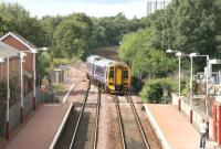A ScotRail 158 comes off the Anniesland line and crosses over to the up platform  at Maryhill to pick up the waiting passenger on a sunny afternoon in August 2006. The train is 15 minutes from its ultimate destination at Glasgow Queen Street. <br><br>[John Furnevel&nbsp;/08/2006]