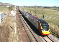 The 1140 Glasgow Central - London Euston Virgin Pendolino glides south through the site of Lamington station on 27 March 2017. Nothing remains of the station itself, which closed to passengers at the end of 1964, although the location is now used as an access point by Network Rail. [See image 6561]<br><br>[John Furnevel&nbsp;27/03/2017]