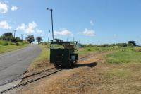 Motor trolley at the La Vallee turning circle of the St Kitts Scenic Railway. The trolley runs ahead of the passenger train with the driver operating some of the level crossing barriers. It is sitting on the points leading to the disused west coast section of the line to Basseterre which continued south from here.<br><br>[Mark Bartlett&nbsp;18/02/2017]