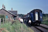 A shot of the last train to Forfar taken on 5.6.82 showing passengers disembarking at Burrelton. Track-lifting commenced the following Autumn.<br><br>[Graeme Blair&nbsp;05/06/1982]