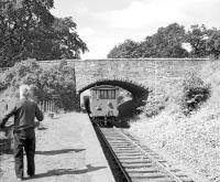 Station master Scott watches the last freight leaving Gordon station, Berwickshire, on 16 July 1965. The photograph may be familiar - it is the front cover photograph used for <a target=article href=https://www.railscot.co.uk/page/bordermemoriesbook>Memories of Lost Border Railways</a> by Bruce McCartney.<br><br>[Bruce McCartney&nbsp;16/07/1965]