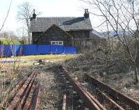 The boarded up former station master's house at Beattock in March 2017. View is east with the WCML passing directly behind the camera. The station buildings themselves are long gone [see image 37674]. [Ref query 988].<br><br>[John Furnevel&nbsp;27/03/2017]