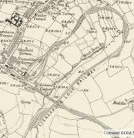 Extract from a 6 inch map from around 1913 showing the curious (unique?) arrangement at Liskeard. In railway terms the scene is little changed today with Looe branch trains departing from the separate station at right angles to the main platforms then dropping down through a 180 degree curve to pass under the main line via Liskeard viaduct [See image 29447]. There are a number of photographs of Liskeard and the Looe line on Railscot.<br><br>[Mark Bartlett&nbsp;//1913]