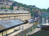 A ScotRail 158 arrives at Waverley's 'sub' platform 20 on June 2006 from Newcraighall with a through service to Dunblane. On the right work is underway on the IECC extension to the Edinburgh Signalling Centre. [See image 9633]<br><br>[John Furnevel&nbsp;08/06/2006]