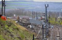 Looking south along the former Waverley Route.  The course of the facing junction and line into the new electric depot are taking shape on the left, while a 66 with the North Blyth - Fort William alumina train is stopped due to a landslip in the Glasgow area. 4 April.<br><br>[Bill Roberton&nbsp;04/04/2017]