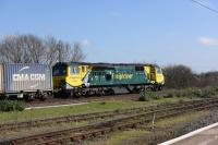 Freightliner 70010 passes eastbound through Didcot with a container train on 15 March 2017.<br><br>[Peter Todd 15/03/2017]