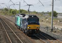 After two days of loaded test trains new DRS electro diesel 88002 <I>Prometheus</I> returned to light engine running on 5th April 2017. The loco, with pantograph rising for the Hest Bank crossing, is seen returning to Carlisle after a trip to Crewe. <br><br>[Mark Bartlett&nbsp;05/04/2017]