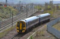 158 705 passes the site of the demolished Millerhill Depot with a Tweedbank service.<br><br>[Bill Roberton&nbsp;04/04/2017]