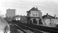 The signal box at Busby Junction is approached by a Barrhead bound DMU.<br><br>[Ian Millar 29/01/1974]