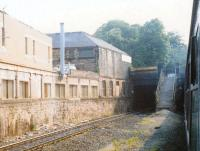 The former station at Newington viewed from a diverted Edinburgh to Birmingham train in 1989. Is that a small Buddleia just visible on the far side of the steps? Apart from that the area was fairly free of vegetation. For comparison [see image 54972].<br><br>[Charlie Niven&nbsp;/07/1989]