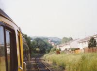 View from a diverted Birmingham train travelling around the Sub. The then recently-built houses have taken the place of sidngs. A CWR expansion joint is visible on the Up line. For details [see image 55375].<br><br>[Charlie Niven&nbsp;/07/1989]