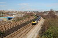 The 0745 from London Paddington to Swansea passing what was the site of Hafod Jct where the Morriston Branch diverged to the right and passed under Landore Viaduct which can be seen on the extreme right of the picture.<br><br>[Alastair McLellan&nbsp;24/03/2017]