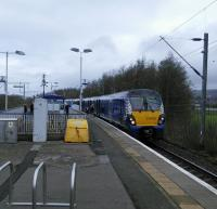 A 334 on an Edinburgh service calls at Dumbarton East on 01/04/2017.<br><br>[David Panton&nbsp;01/04/2017]