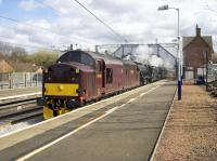 WCRC 37518 leads Black 5s 45212 and 45407 north through Uddingston on 10 April 2017 with <I>the Jacobite</I> on an empty carriage movement from Carnforth to Fort William. <br><br>[Colin McDonald&nbsp;10/04/2017]