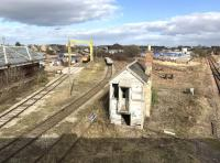 View east from New Elgin Road bridge on the afternoon of 4 April 2017.  The former Elgin East station stands on the left, with the main Inverness – Aberdeen line on the right disappearing towards Keith. (Elgin station is behind the camera on the west side of the bridge.)  The abandoned Elgin East signal box still survives in the centre, while beyond the gantry crane two class 66 locomotives are stabled with a PW train. A line of wagons loaded with new track panels stands in the sidings.<br><br>[Andy Furnevel&nbsp;04/04/2017]