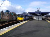 A Cumbernauld service starts it's journey from Platform 3 at Dumbarton Central on 01/04/2017. To the left Dumbarton Municipal Buildings undergo restoration.<br><br>[David Panton&nbsp;01/04/2017]