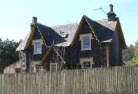 Front view of the fenced off (and slightly creepy looking) former station master's house at Beattock. Photographed looking west in April 2016, with the WCML running past just beyond. [see image 58672].<br><br>[John Furnevel&nbsp;27/03/2017]